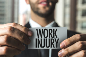 man holding work injury sign