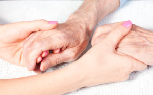 image of two pairs of holding hands